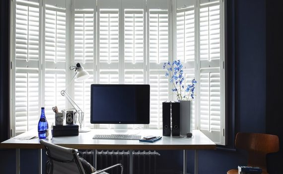 Plantation shutters installed in Dallas home office.