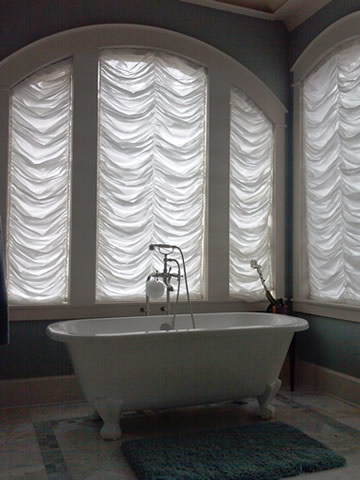 Arched shades and sheers in Fort Worth bathroom